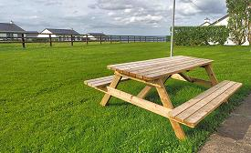 Picnic tables at Quilty Cottages